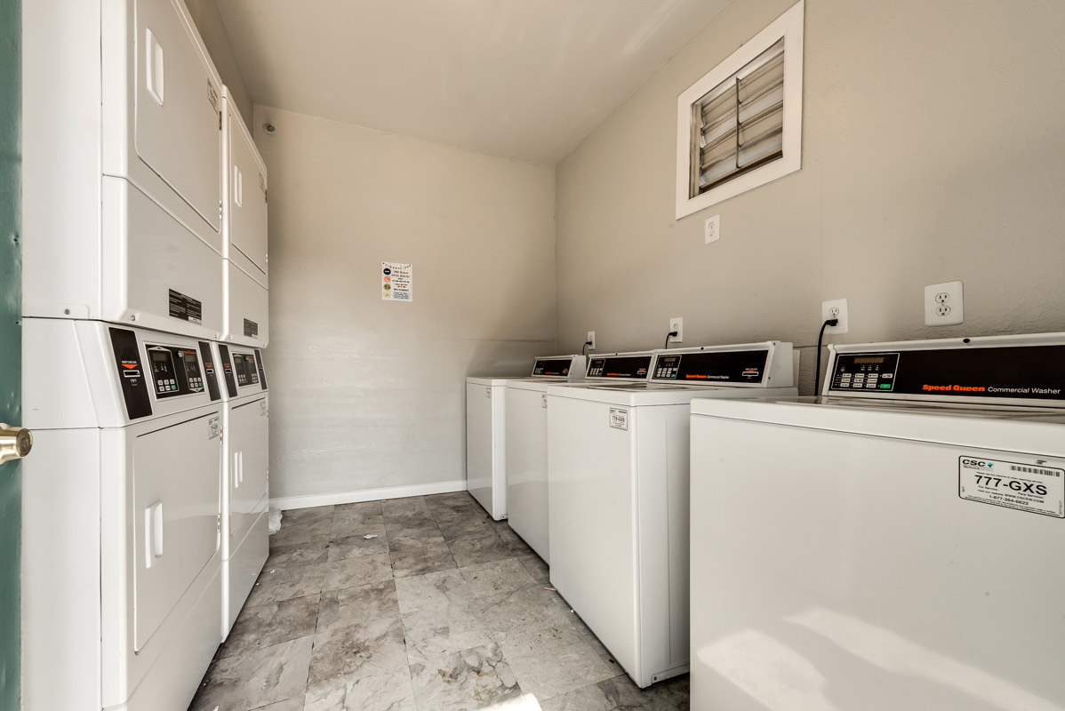 Laundry Center at Mill House Apartments in Dallas, TX