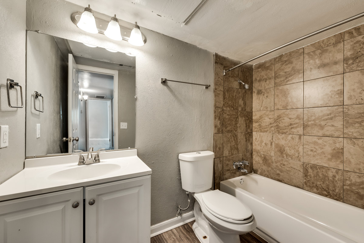 Updated Bathroom at Mill House Apartments in Dallas, TX