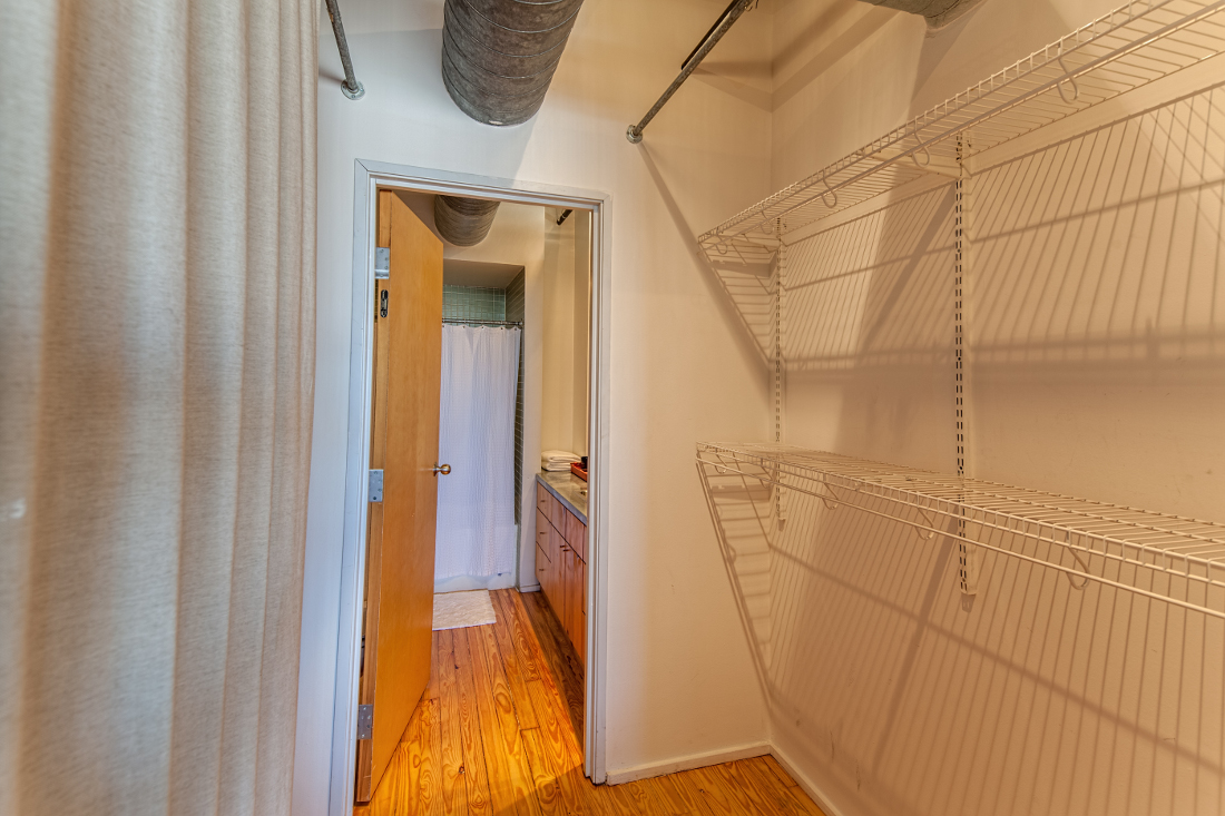 Walk-in Closet at the Mitchell Lofts Apartments in Dallas, TX
