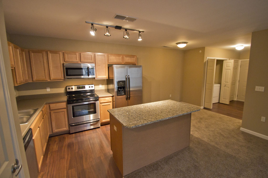 Apartments for Rent with Wood-Look Flooring in Kitchens at Montclair Village in West Omaha, NE.