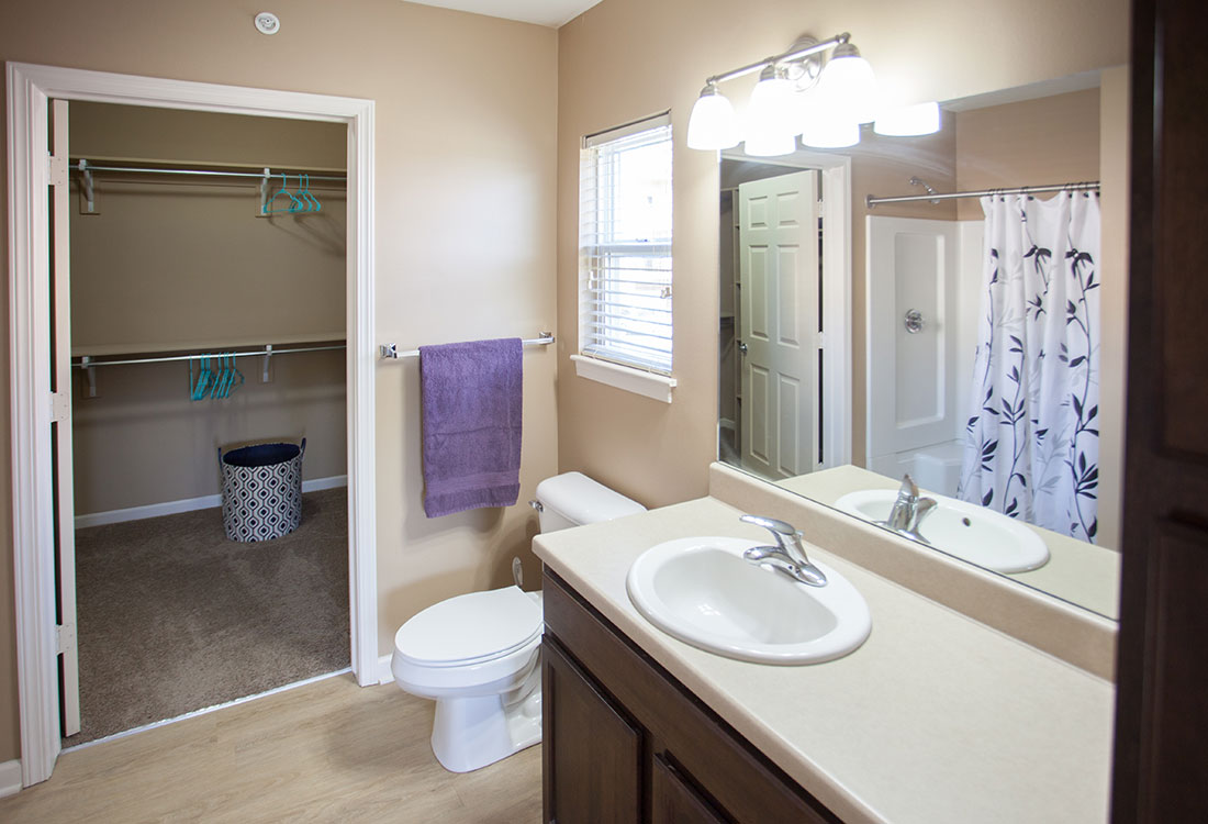 Bathroom with Walk-In Closets at Montclair Village Apartments in Omaha, Nebraska