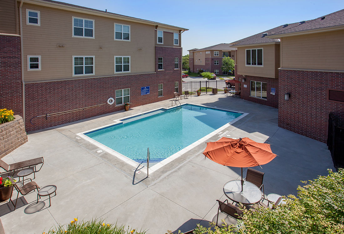 Poolside Lounging Area at Montclair Village Apartments in Omaha, Nebraska