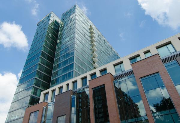 Magnolia Capital Acquires 270-Unit High Rise Apartment Building in Thriving Chicago Suburb
