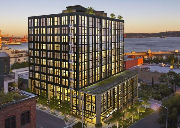 The Schuster Group Celebrates Topping-Off of 12-Story High-End Walton Lofts in Seattle