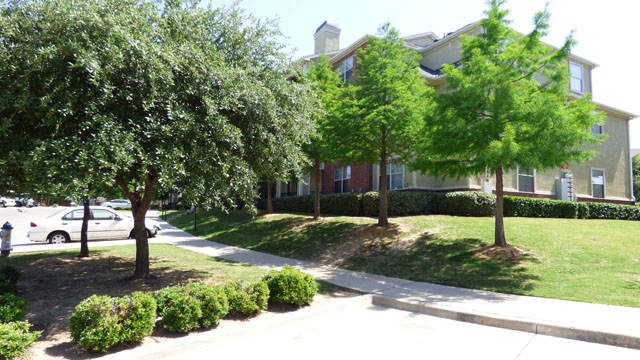 Lush Landscaping at Murdeaux Villas Apartments in Dallas, TX
