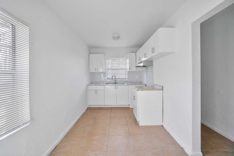 White Kitchen at New Castle Lake Apartments in Miami, FL