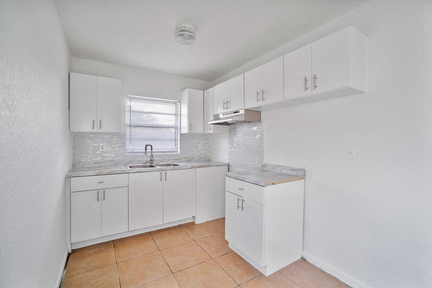 Kitchen at New Castle Lake Apartments in Miami, FL