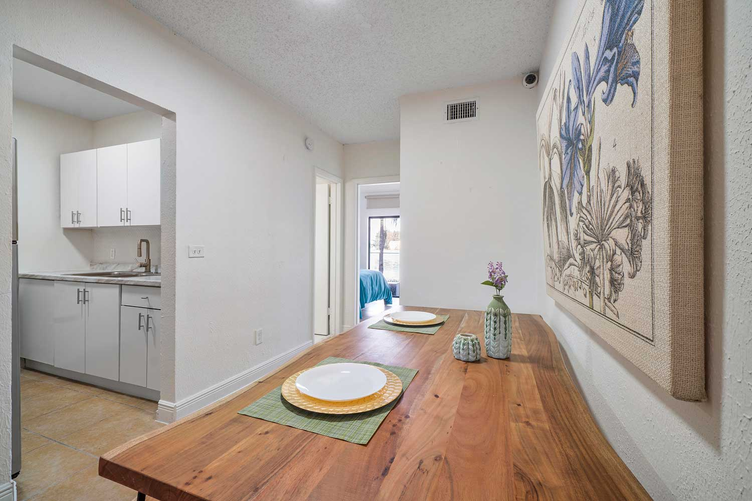 Wood Dining Table at New Castle Lake Apartments in Miami, FL
