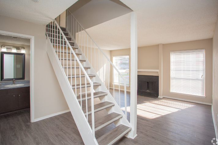 Fireplaces and Beautiful Flooring at The Cassidy at Western Hills Apartments in Fort Worth, Texas