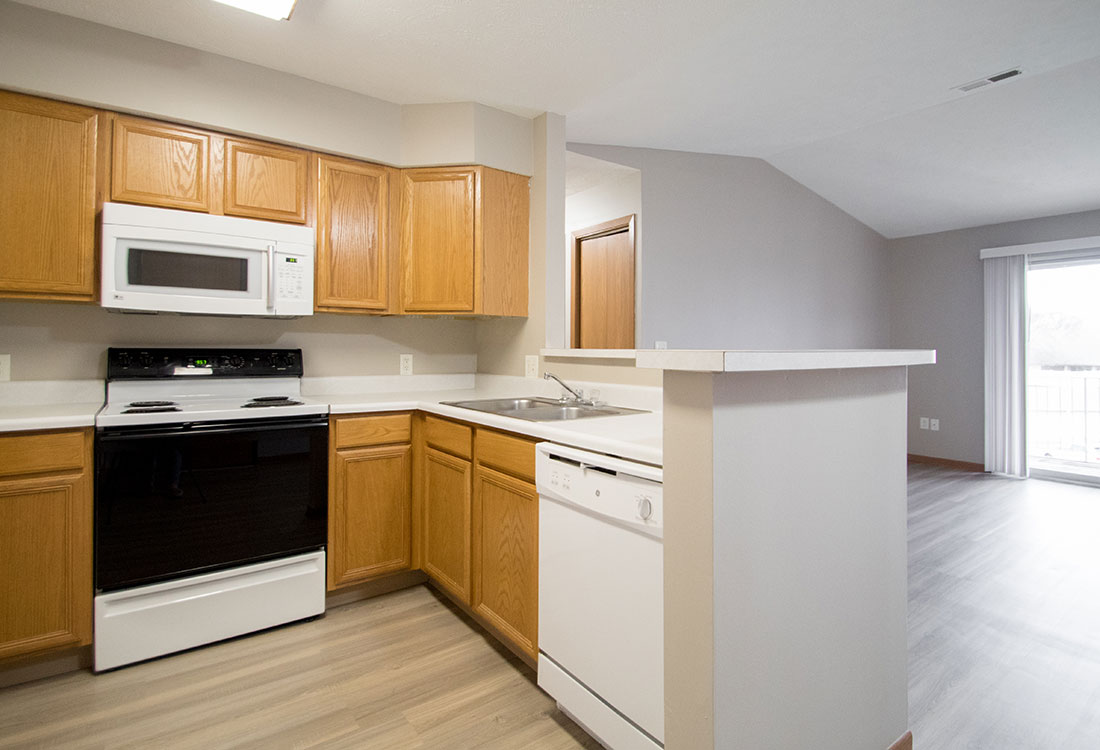 Beautiful Kitchens with Upgraded Plank Flooring at Northridge Apartments in Gretna, Nebraska
