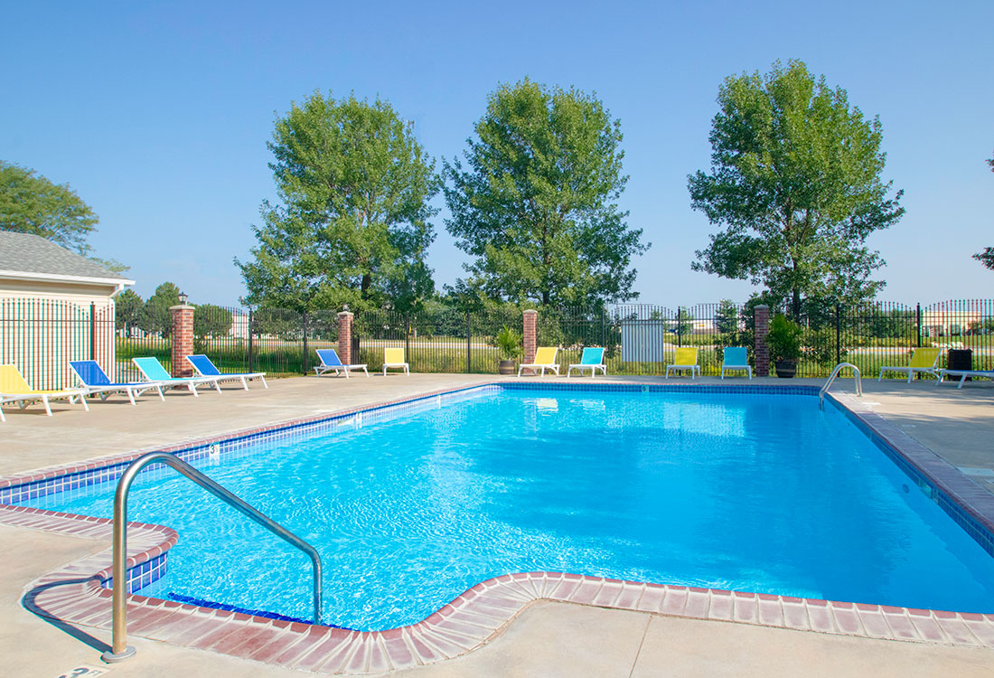 Swimming Pool with New Patio Furniture at Northridge Apartments in Gretna, Nebraska