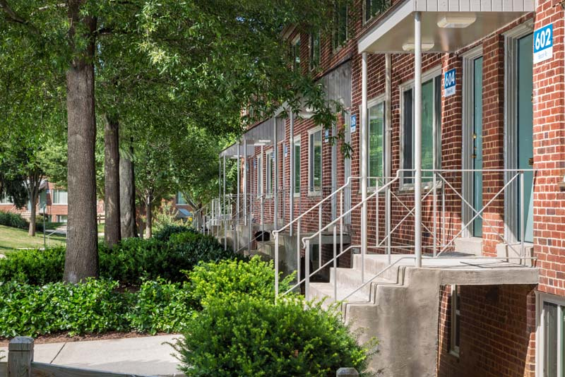 Two-level townhomes with private covered entry at Northwest Park Apartments in Silver Spring, MD
