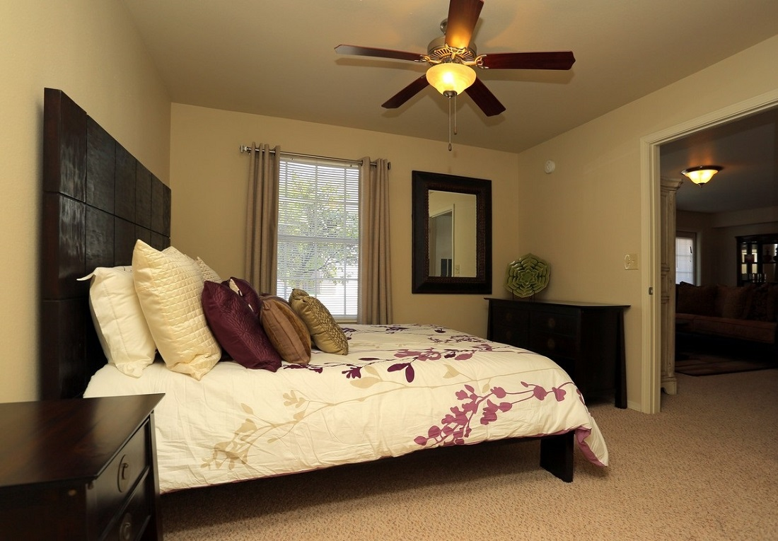 Bedroom Interior at the Oakmont Apartment Homes in Catoosa, OK