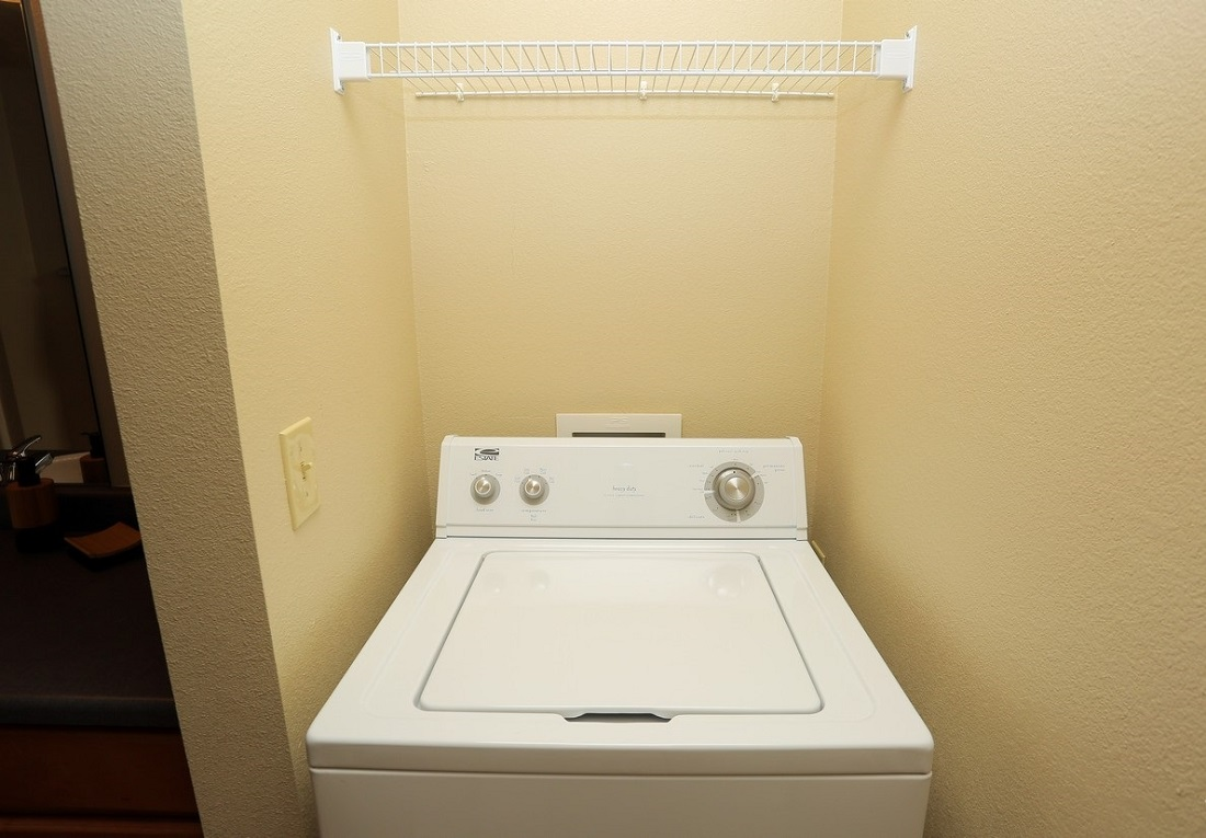 Laundry Area at the Oakmont Apartment Homes in Catoosa, OK