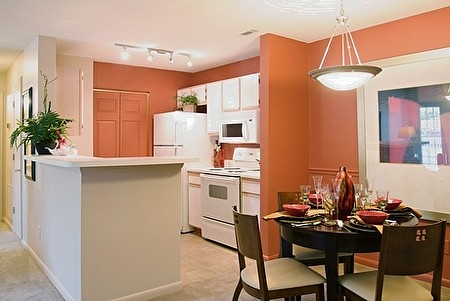 Dining with View of Kitchen at the Oak Pointe Apartment Homes in Simpsonville , SC