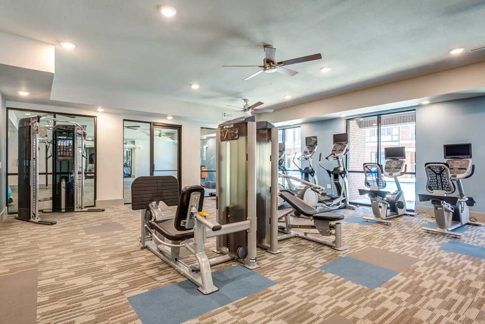 Weight Machines at Oaks 55 Apartments in Euless, TX