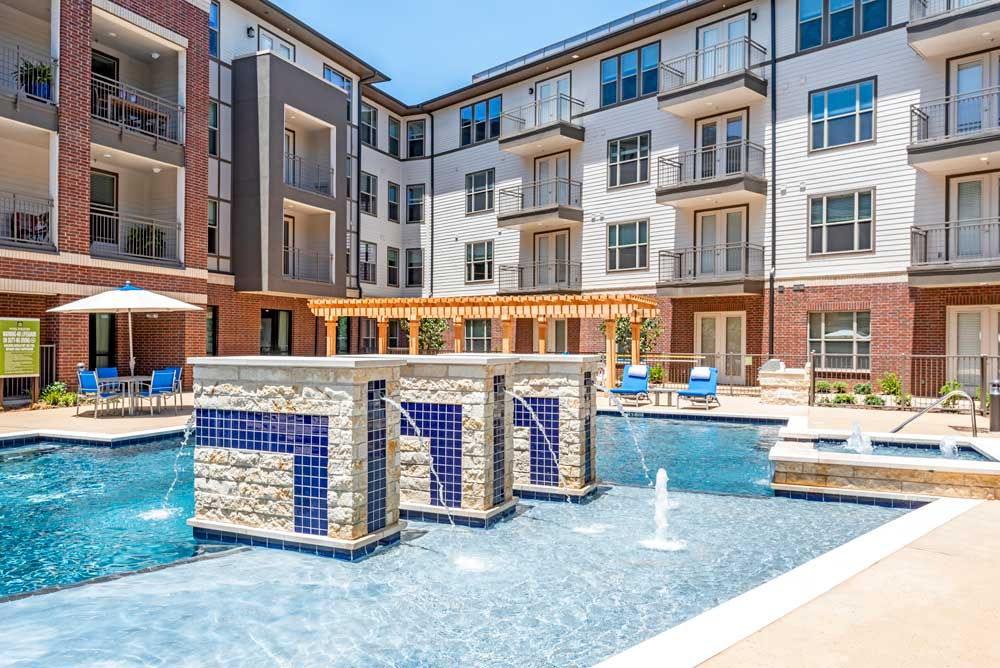 Resort-Style Swimming Pool at Oaks 55 Apartments in Euless, TX