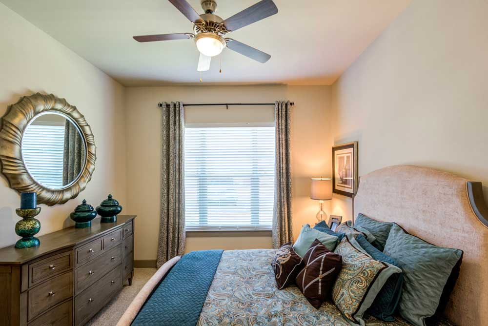 Cozy Bedroom at Oaks 55 Apartments in Euless, TX