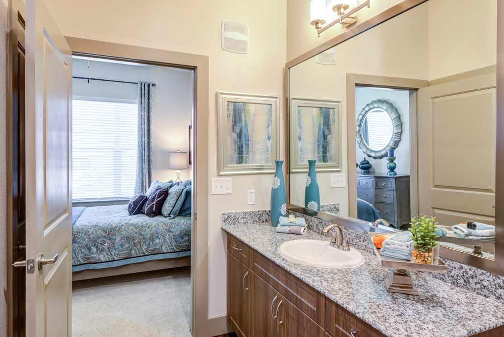 Bedroom with Bathroom at Oaks 55 Apartments in Euless, TX