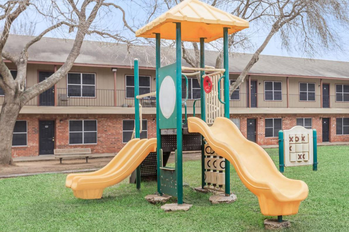 Children's Playground at Oaks at Mustang Apartments in Alvin, TX