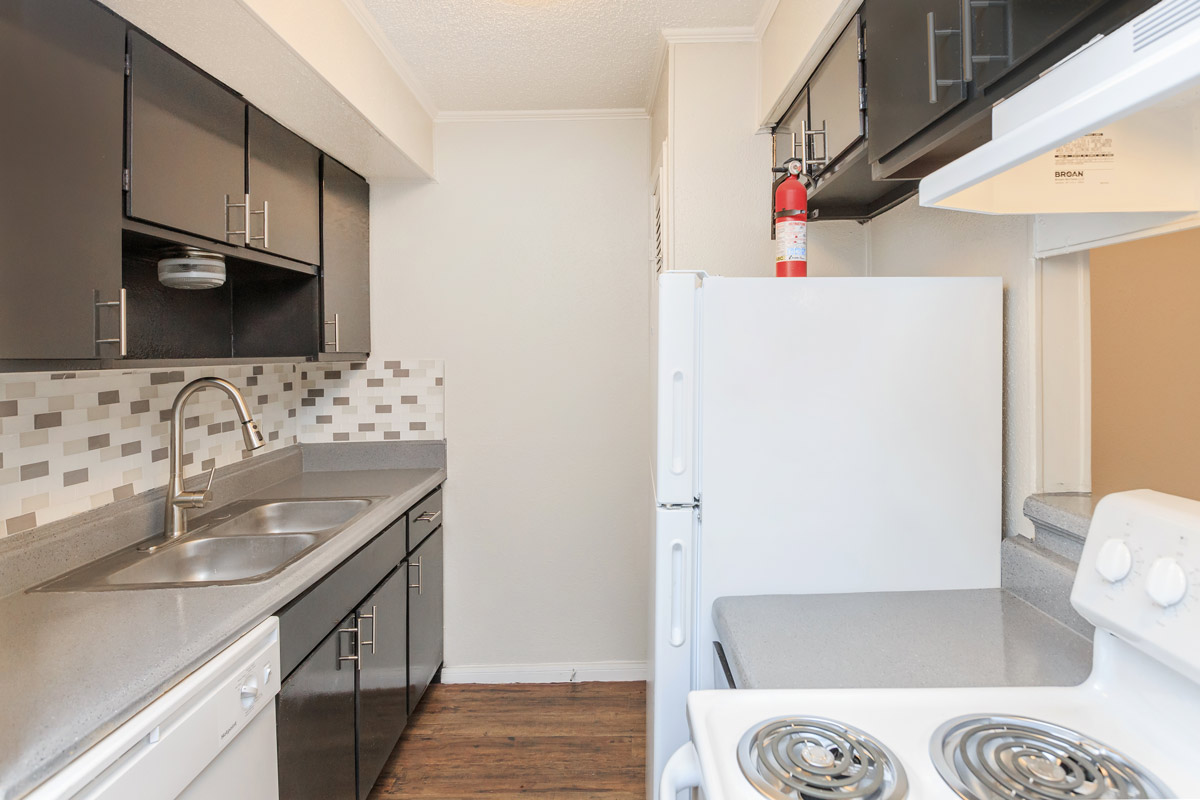 White Kitchen Appliances at Oaks at Mustang Apartments in Alvin, TX