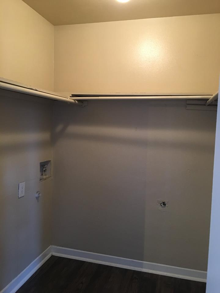 Walk-In Closet with Shelves at Ocean Drive Estates Apartments in Corpus Christi, TX