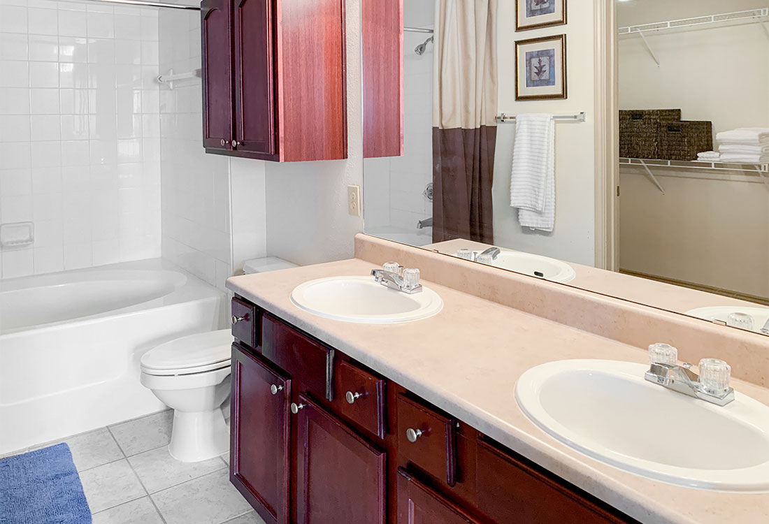 Spacious Bathrooms with Double Sinks at Preserve at Old Dowlen Apartments in Beaumont, TX