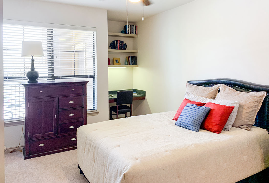 Bedrooms with Built-In Shelving at Preserve at Old Dowlen Apartments in Beaumont, TX