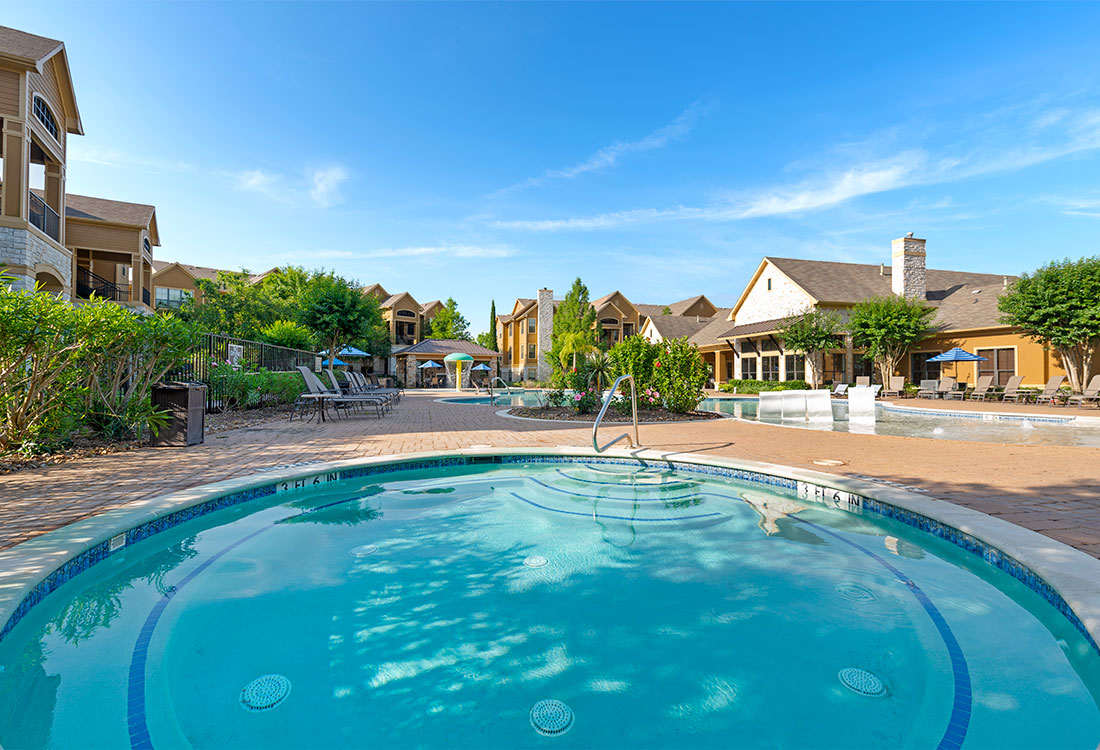 Resort-style Pool at Preserve at Old Dowlen Apartments in Beaumont, TX