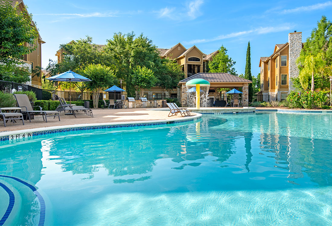 Poolside Lounge Area at Preserve at Old Dowlen Apartments in Beaumont, TX