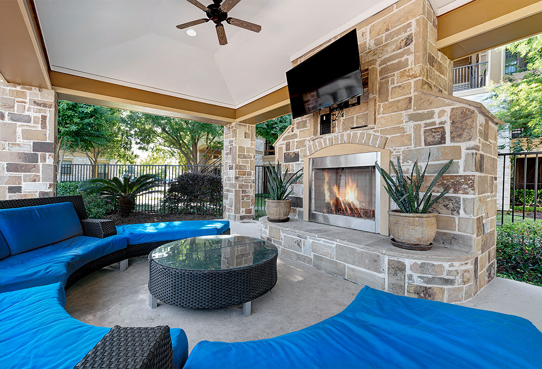 Outdoor Lounge with a Fireplace at Preserve at Old Dowlen Apartments in Beaumont, TX