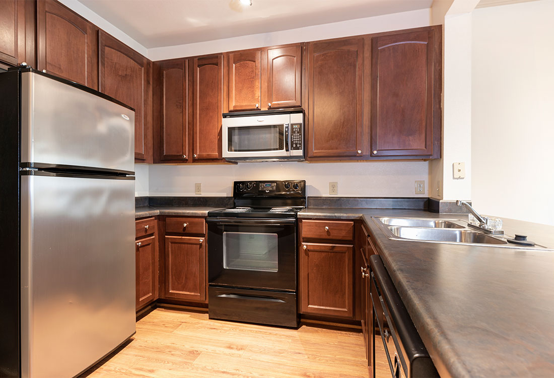 Fully Equipped Kitchen at Preserve at Old Dowlen Apartments in Beaumont, TX