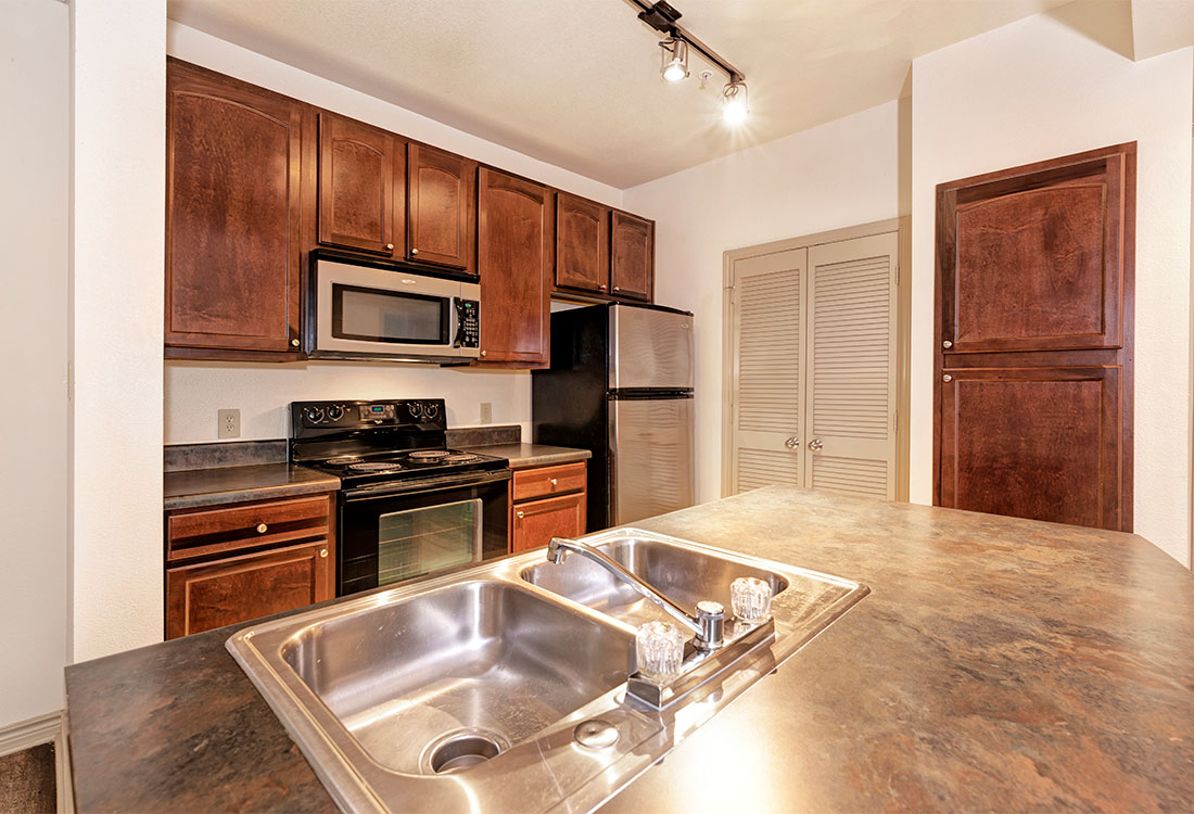 Double Sink in the Kitchen at Preserve at Old Dowlen Apartments in Beaumont, TX