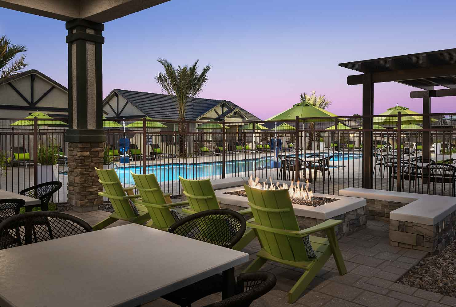 Swimming Pool Lounge at Olive Marketplace Apartments in Glendale, AZ