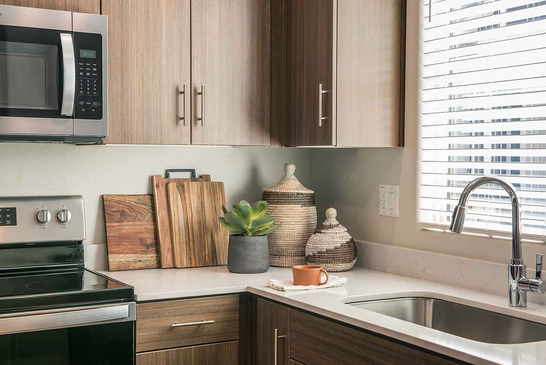Kitchen at Olive Marketplace Apartments in Glendale, AZ