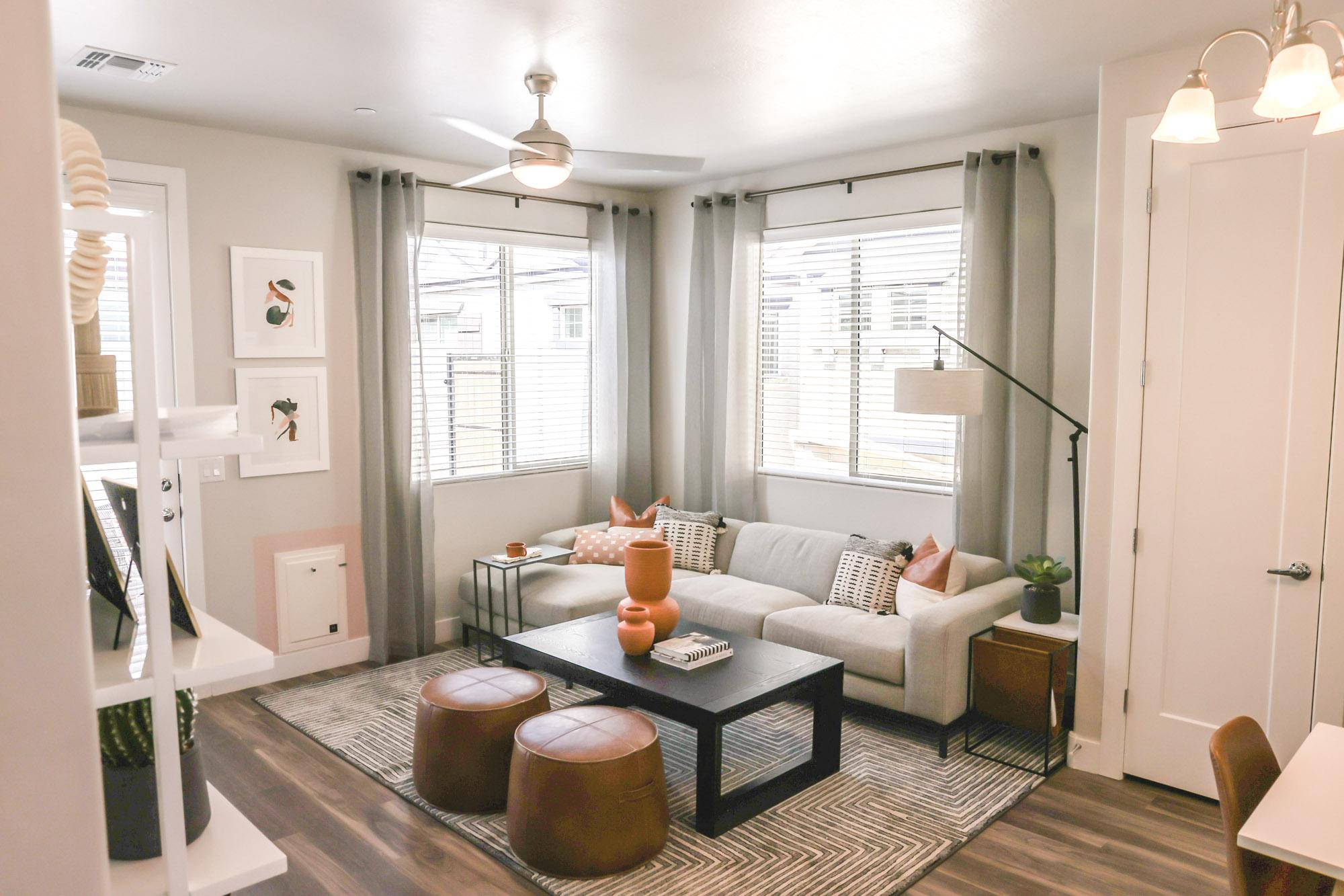 LIving Room at Village at Olive Marketplace Apartments in Glendale, AZ