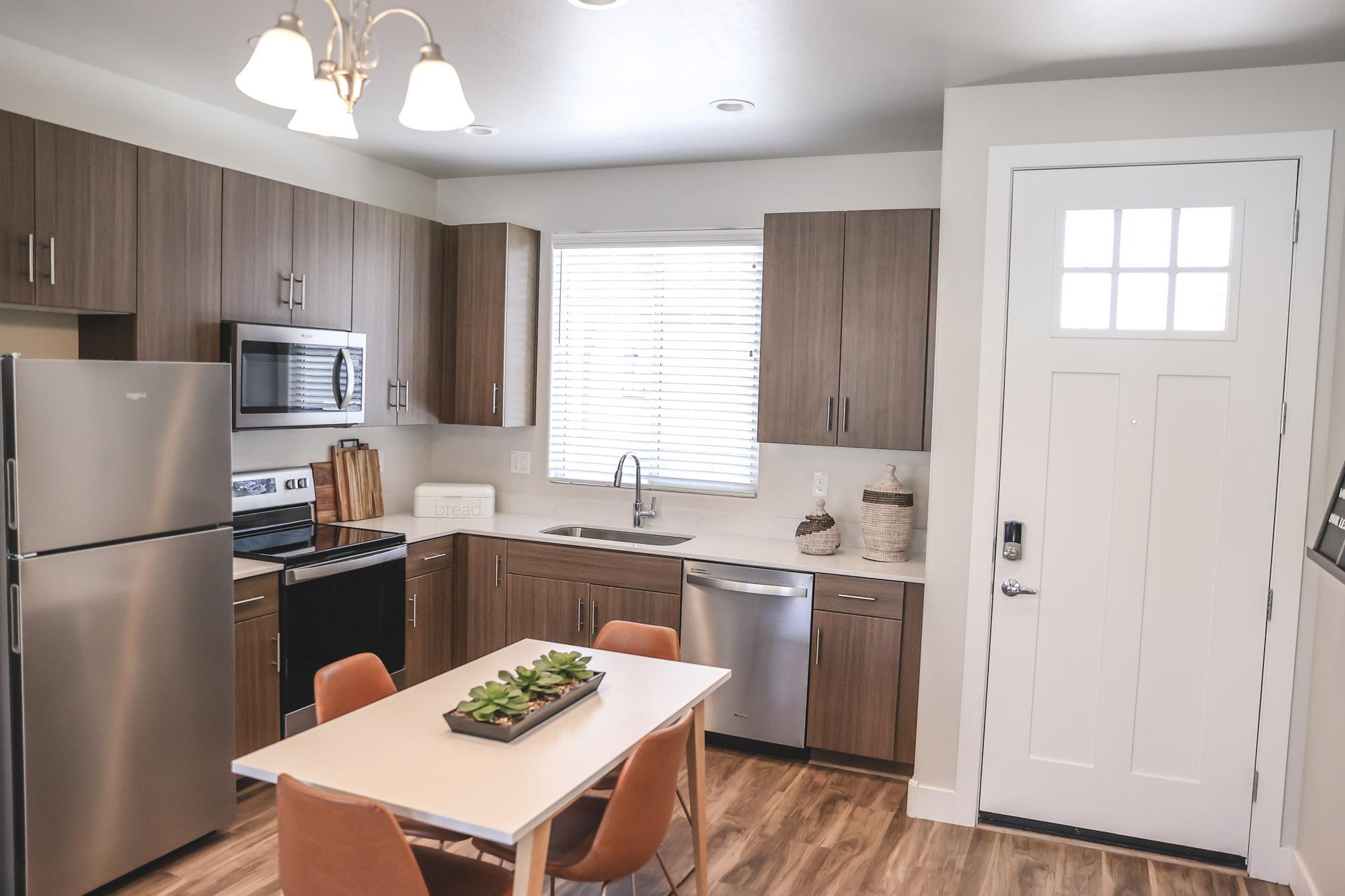 Kitchen at Village at Olive Marketplace Apartments in Glendale, AZ