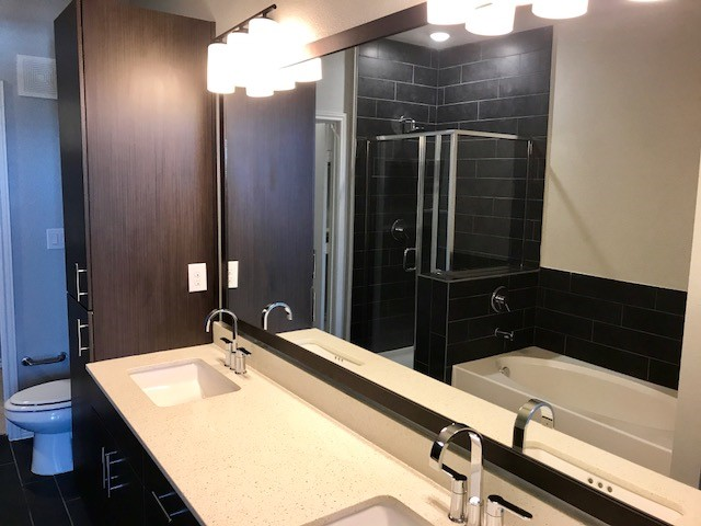 Large Bathroom Vanities at Oxford at Medical Center Apartments in San Antonio, Texas