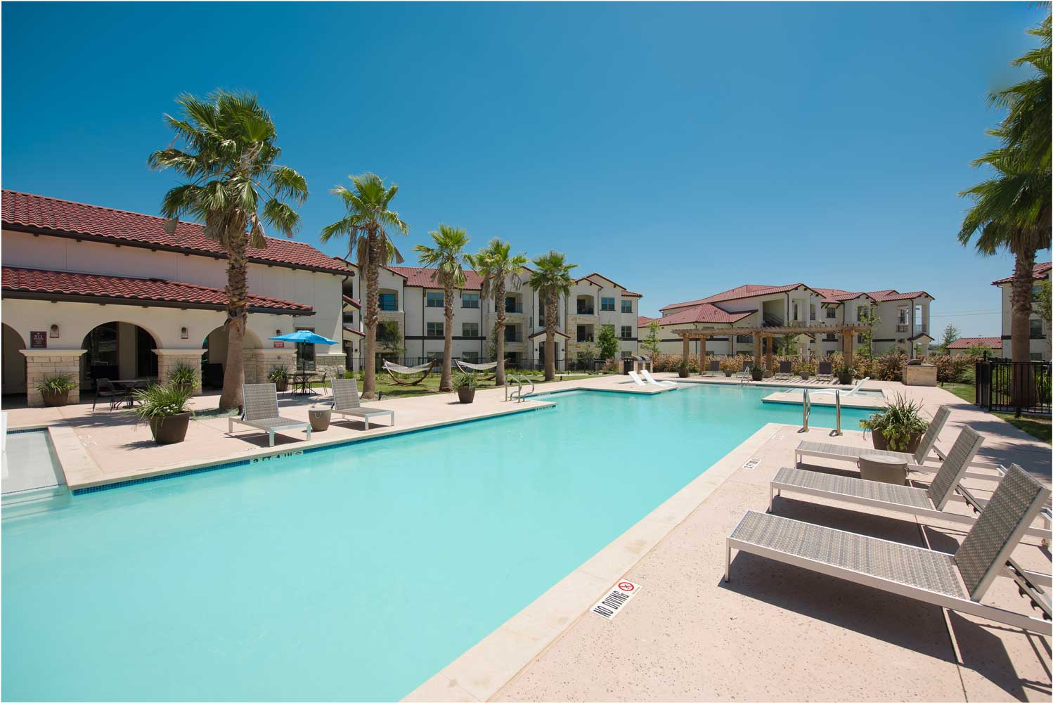 Sparkling Pool at Oxford at Santa Clara Apartments in Pflugerville, Texas