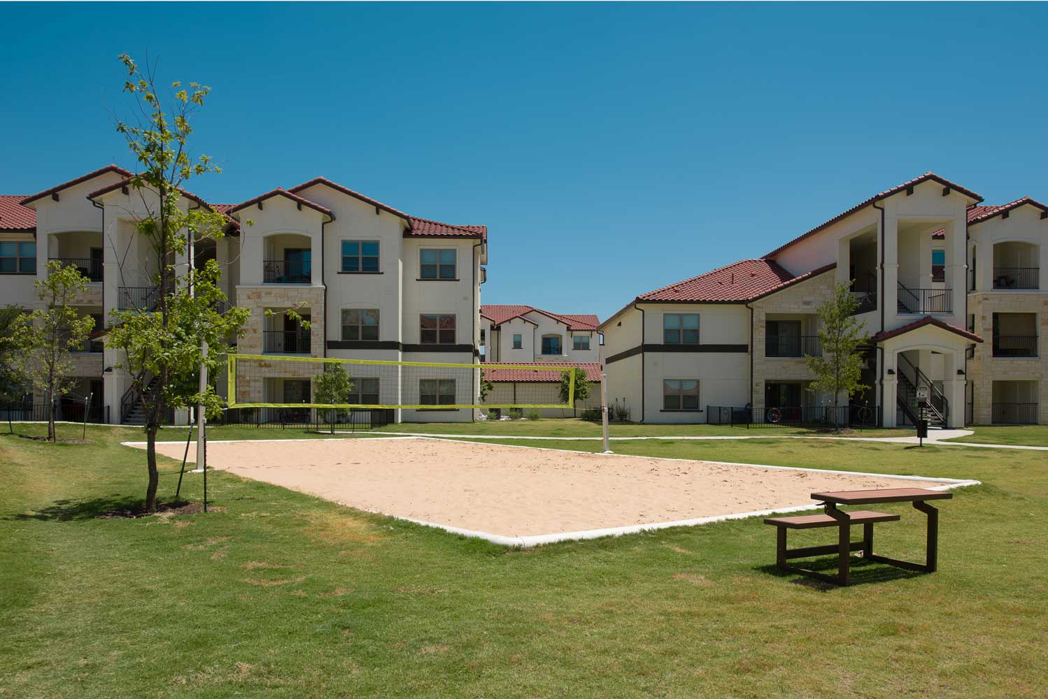 Volleyball Court at Oxford at Santa Clara Apartments in Pflugerville, Texas
