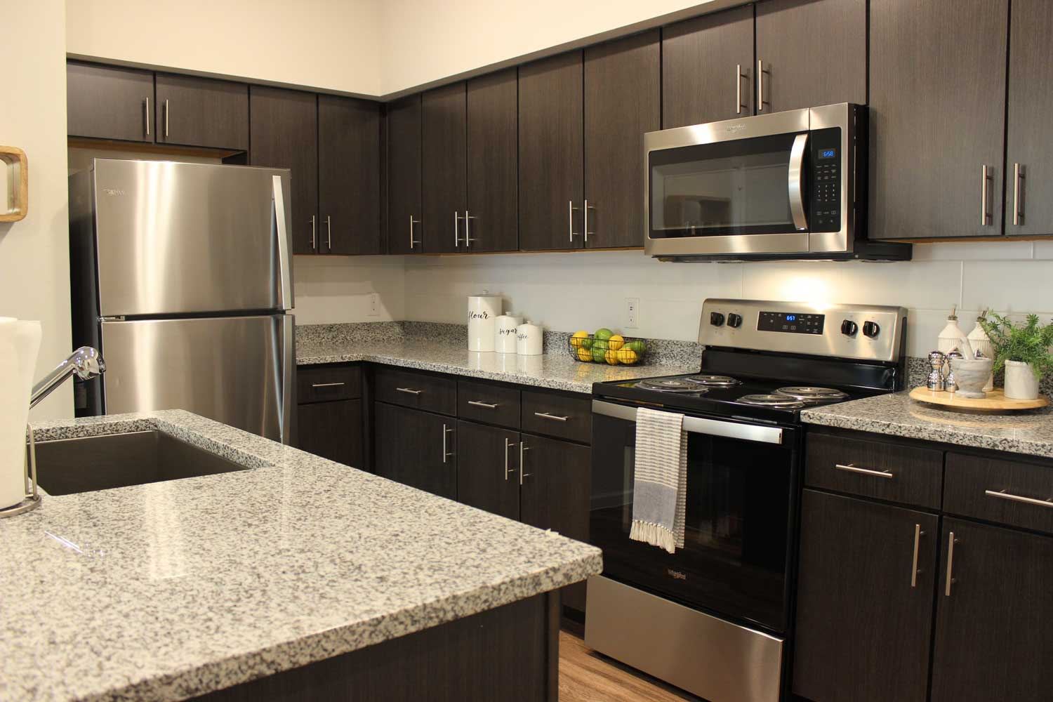 Fully Equipped Kitchen at Oxford at Santa Clara Apartments in Pflugerville, Texas