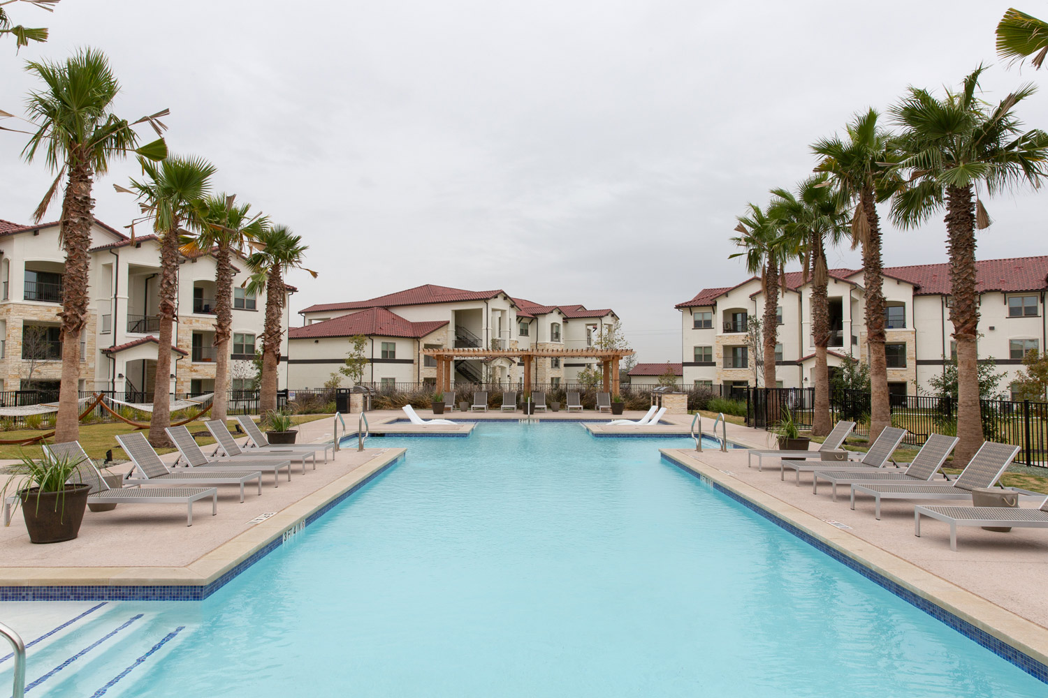 Resort-Style Swimming Pool at Oxford at Santa Clara Apartments in Pflugerville, Texas