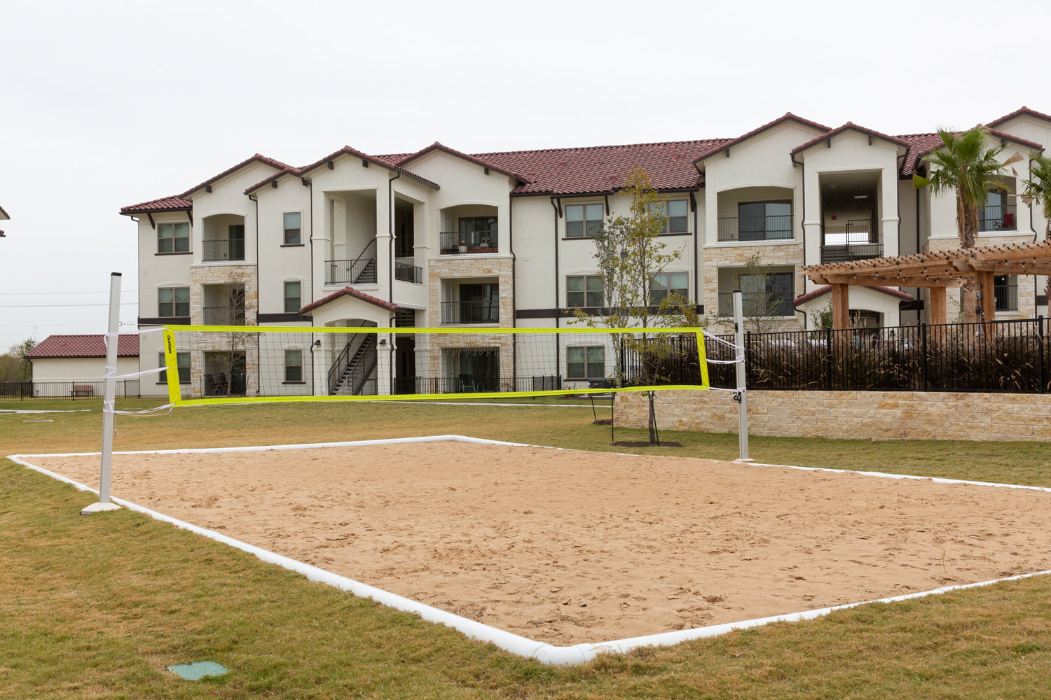 Sand Volleyball Court at Oxford at Santa Clara Apartments in Pflugerville, Texas
