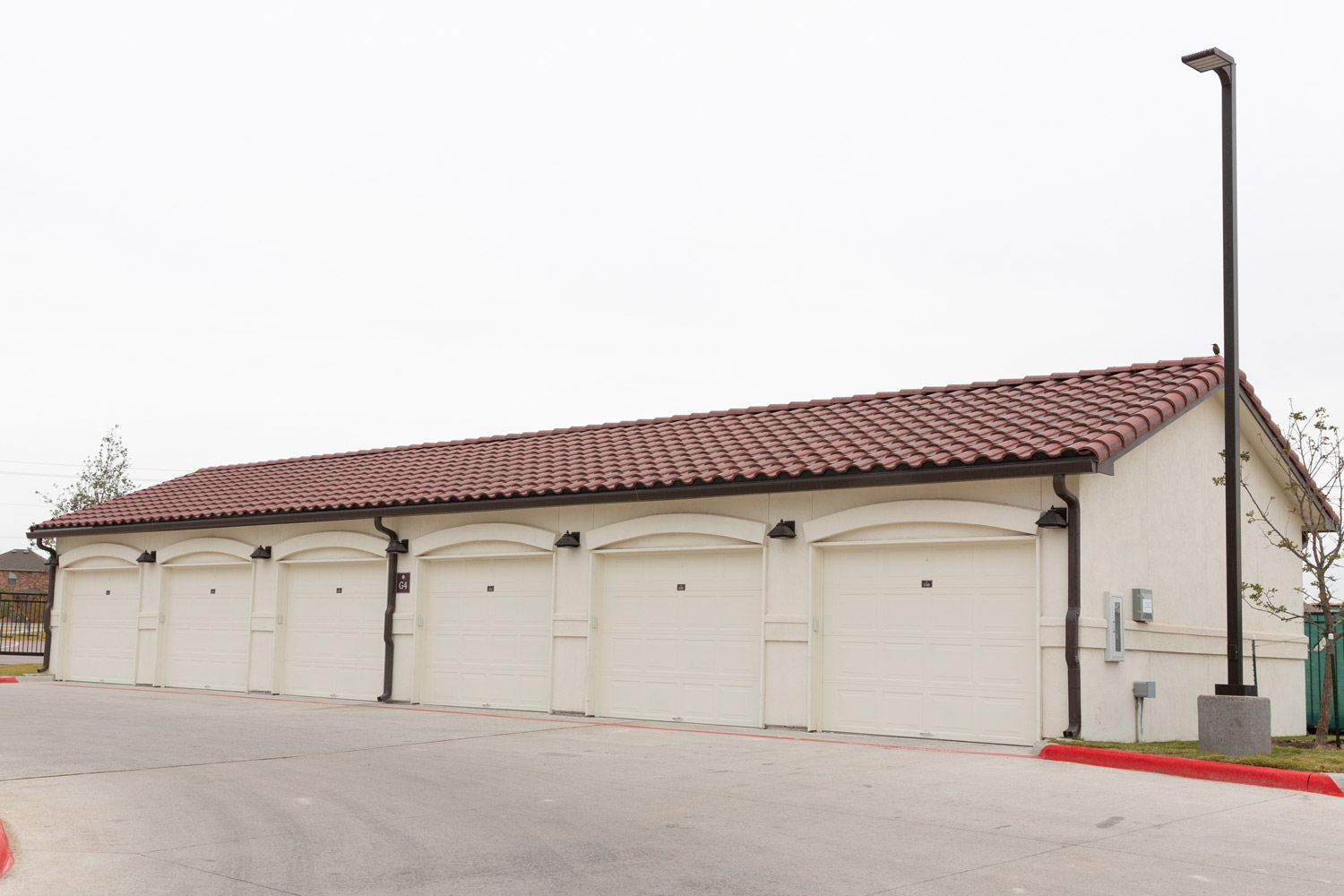 Garage Parking at Oxford at Santa Clara Apartments in Pflugerville, Texas