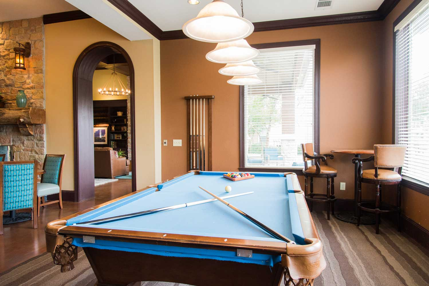 Pool Gaming Area at the Oxford at Country Club Apartments in Baytown, TX