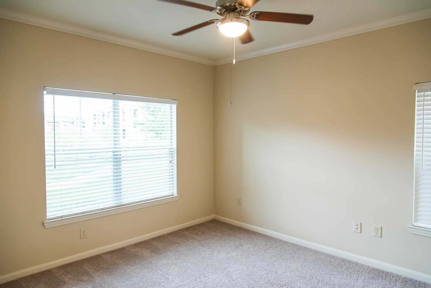 Room with Ceiling Fan at the Oxford at Country Club Apartments in Baytown, TX