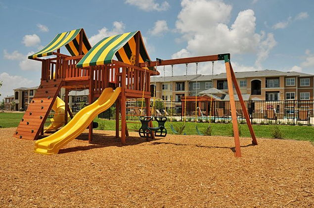 Playground at the Oxford at Country Club Apartments in Baytown, TX