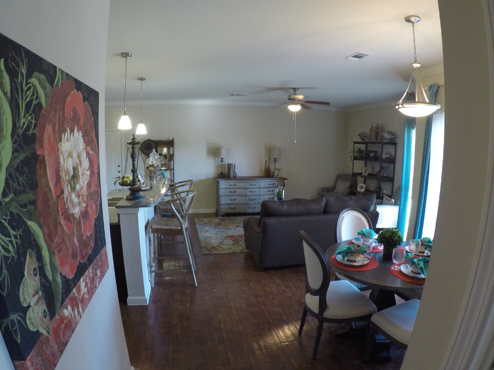 Kitchen, Dining and Living Room at the Oxford at Country Club Apartments in Baytown, TX