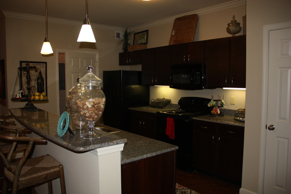 Kitchen at the Oxford at Country Club Apartments in Baytown, TX