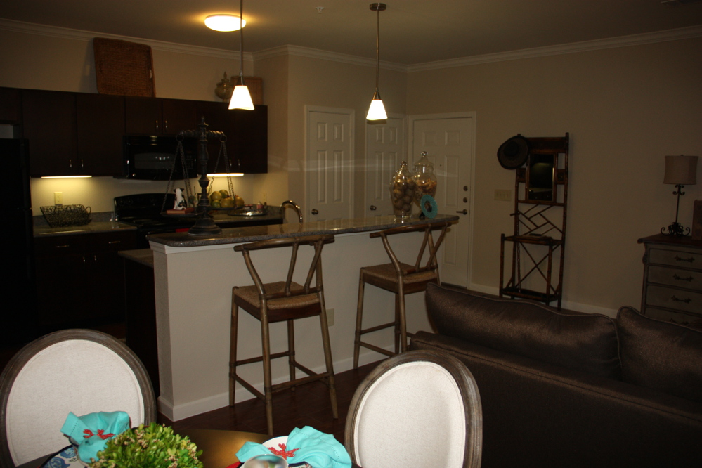 Open Kitchen and Dining Area at the Oxford at Country Club Apartments in Baytown, TX